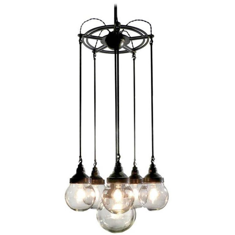 Six Globe Armory Chandelier For Sale