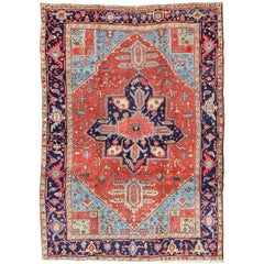Antique Persian Heriz Carpet with Stylized Geometric Medallion in Reds and Blues