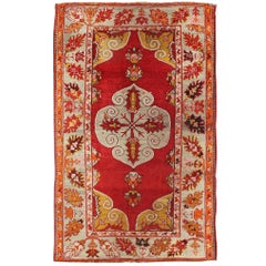 Antique Turkish Oushak Rug with Bright Red Ground and Center Medallion