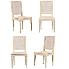 Set of Four French Louis XVI Style Painted Wood and Cane Dining Chairs, 1970s
