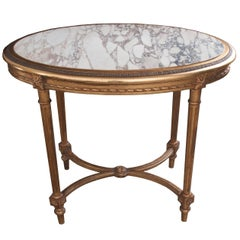 French 19th Century Louis XVI Oval Gold Gilt Table with Marble Top