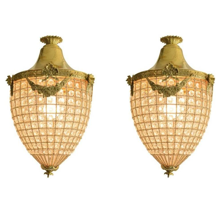 Pair of Bronze Lantern Style Chandeliers with Beaded Glass