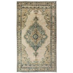 Muted Turkish Rug with Floral Design in Blue, Green, Light Taupe, Ivory & Cream