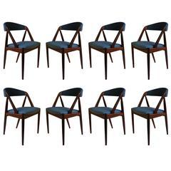 Rosewood Kai Kristiansen Model 31, re-upholstered Set of Eight
