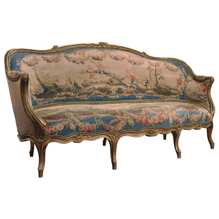 19th century french louis xv carved gilt canap with for Louis xv canape sofa