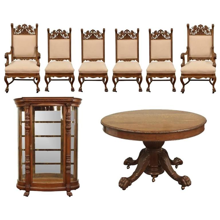 oak dining room set with table chairs and curio cabinet at 1stdibs