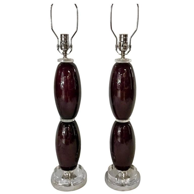 Pair of circa 1950s Murano glass table lamps, eggplant color body, with clear base.  Measurements: 22