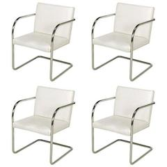 Four Thonet White and Chrome Cantilever Dining Chairs