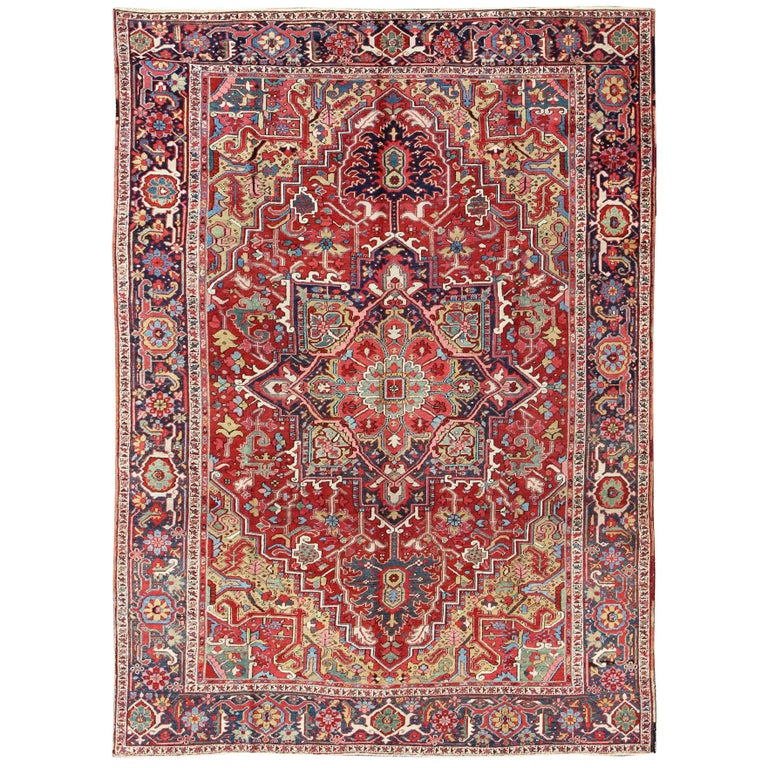 Antique Heriz Carpet with Stylized Floral Motifs and Complementary Border