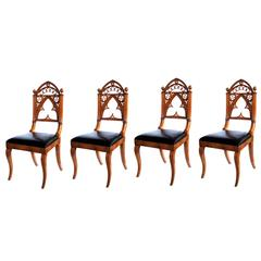 Well-Carved Set of Four Gothic Revival Klismos-Form Walnut Side Chairs