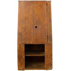 18th Century American Primitive Canted-Front Cabinet