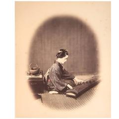 Set of Four Early Hand Coloured Albumen Prints of Japanese Women, circa 1868