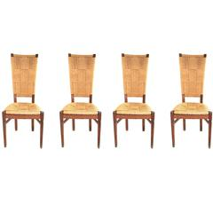 Audoux-Minet, Suite of Four Chairs, Rattan and Wood, circa 1970, France