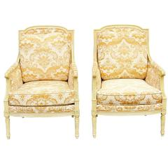 Pair of Distressed Cream Painted Carved Bergeres