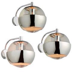 Set of Three Polished Chrome Globe Sconces, circa 1970