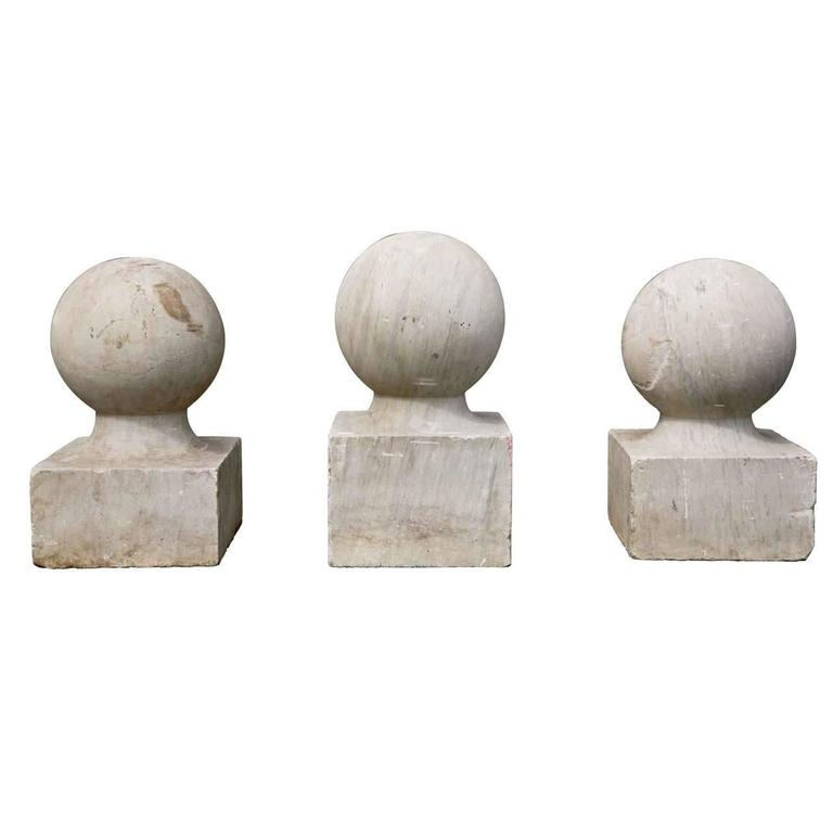 Three Carved Marble Spherical Finials