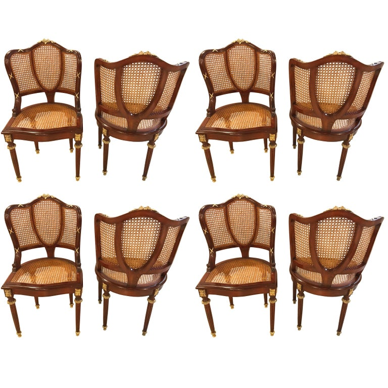 Set of eight fine bronze-mounted Louis XVI style dining chairs. This is a simply magnificent set of Maison Jansen solid mahogany dining chairs each having all-over bronze mounts. The entire set having recently been cleaned and the wood French