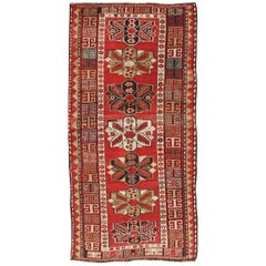 Antique Kazak Runner with Seven Medallions and Tribal Design in Red Background