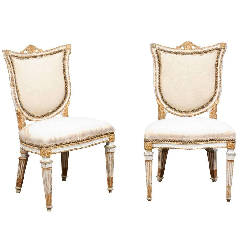 Pair of Italian Neoclassical Painted and Gilded Side Chairs with Shield Backs