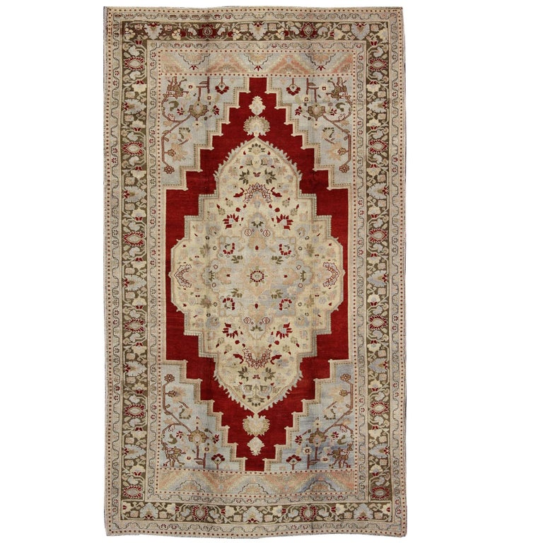 Red Background Turkish Vintage Oushak Rug with Intricate Floral Medallion
