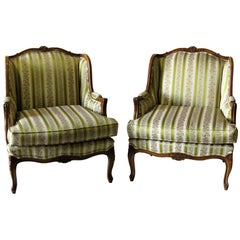 Pair of Louis XV Style Walnut Carved Upholstered Bergères