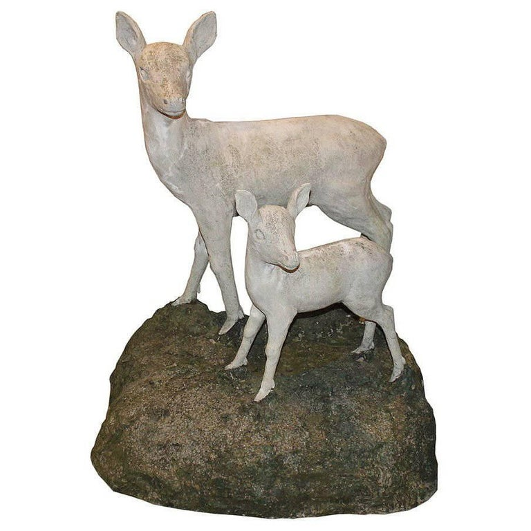 Pair of English Mid-Century Cast Stone Sculptures of a Doe and Her Fawn on Base For Sale