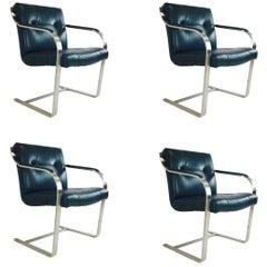 Set of Four Leather and Stainless Cantilever Dining Chairs by Brueton