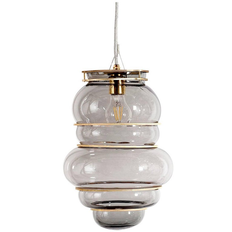 Contemporary Minor Flaws, Mouth Blown Glass Pendant with Brass Rings For Sale