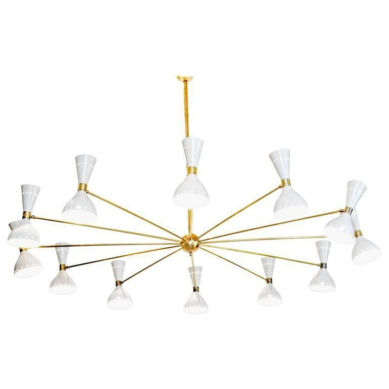 Twelve Arms Natural Patina Brass Chandelier, Ivory Pivoting Heads, Twin Bulbs For Sale