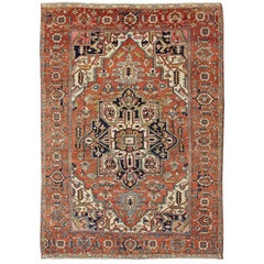 Antique Persian Serapi Rug with Bold Medallion in Orange, Navy Blue and Green