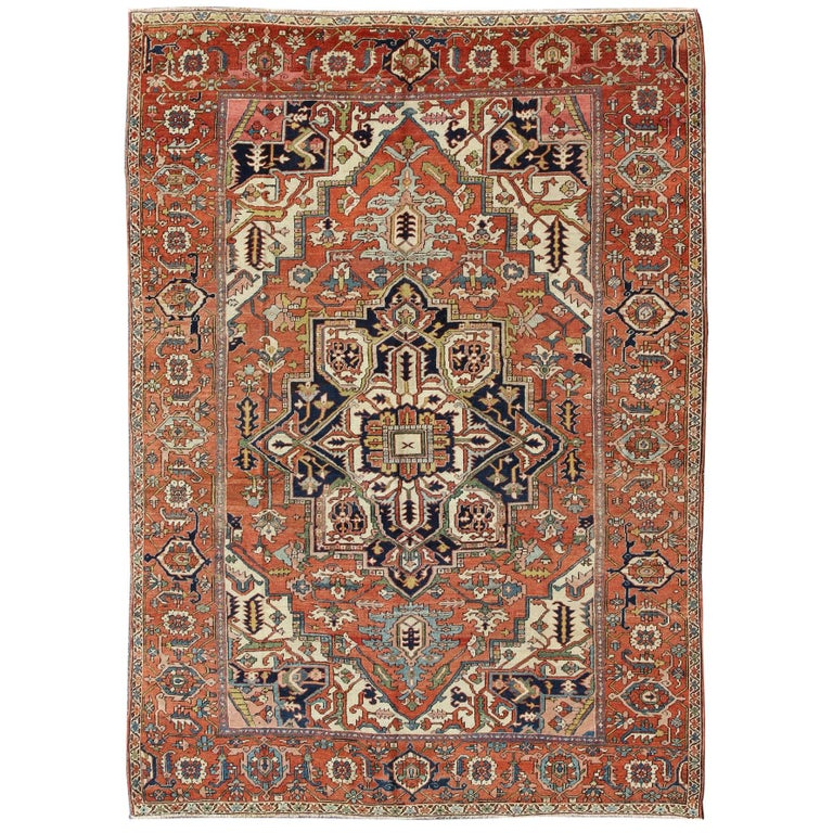 Antique Persian Serapi Rug with Bold Medallion in Orange, Navy Blue and Green For Sale
