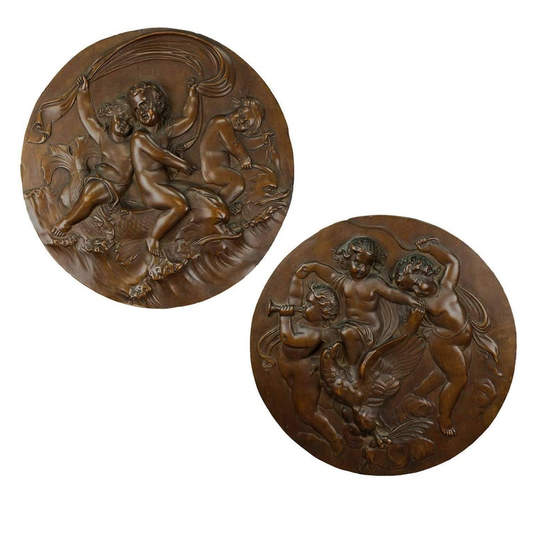 Pair of Elaborate Carved Nutwood Plaques with Putti For Sale