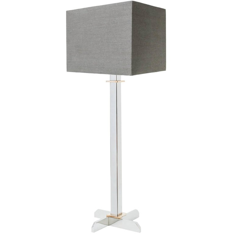 Table lamp in polished stainless steel with polished bronze details For Sale