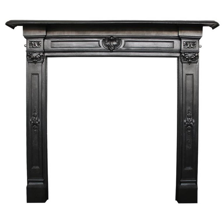For Sale on 1stdibs - An elegant antique early Victorian cast iron fireplace surround