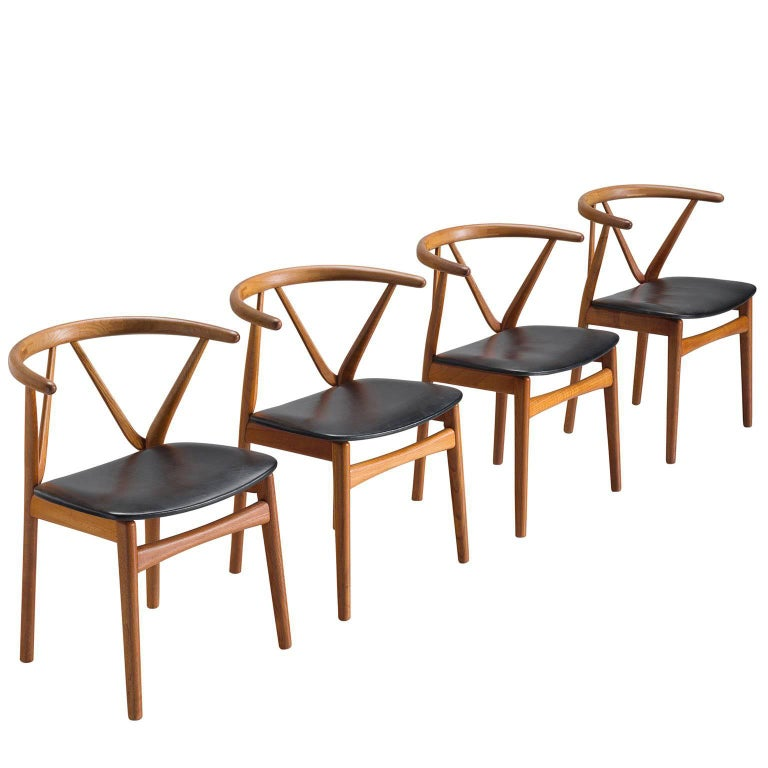 Set of Four Henning Kjaernulf Dining Chairs in Teak and Black Upholstery
