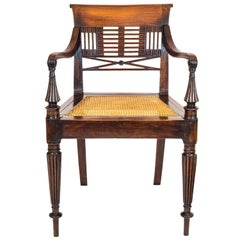 Early 19th Century English Regency Colonial Carved Padouk Campaign Desk Armchair