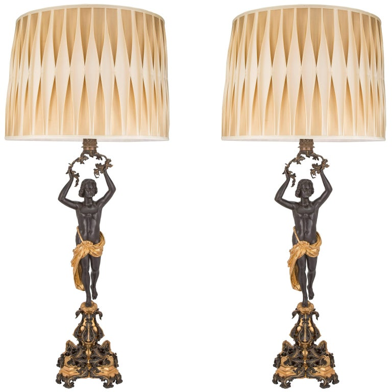 Pair of French 19th Century Charles X Style Patinated Bronze and Ormolu Lamps