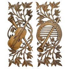 Pair of French Carved Oak Musical Trophies