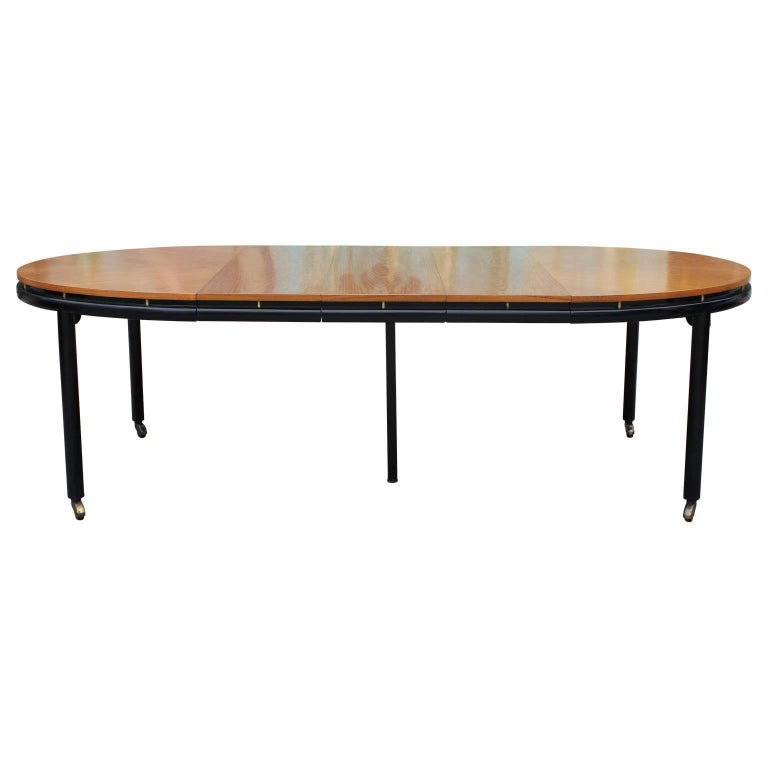 Modern michael taylor for baker walnut three leaf two tone for Modern oval dining room table