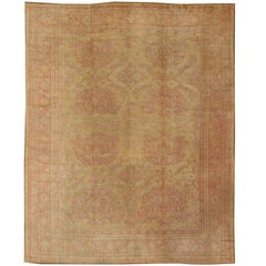 Antique Turkish Oushak Rug with Central Floral Motifs in Muted Red and Cream
