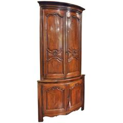 Early 19th Century French Louis XV Carved Walnut Two-Piece Bombe Corner Cabinet