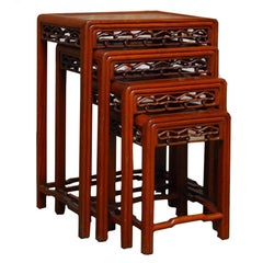 Set of Four Chinese Carved Hardwood Nesting Tables