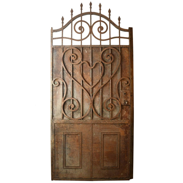 Arched Iron Door with Scrollwork, circa 1900