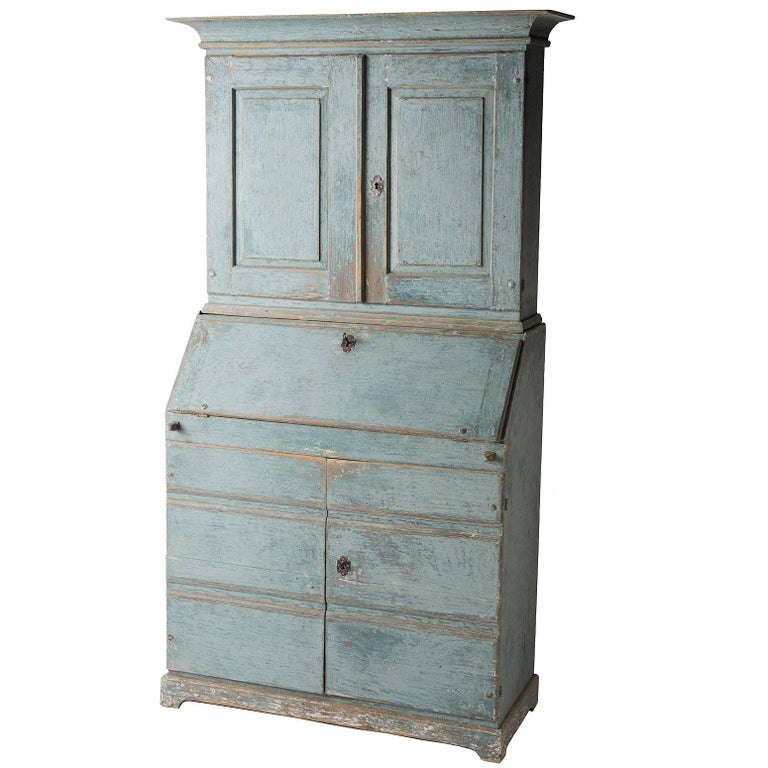 A wonderful Swedish blue, this stately secretary has a number of great details that highlight the work of a talented calligrapher. The interior drawers are beautifully numbered from one to six, a great way to stay organized in style! The inside of