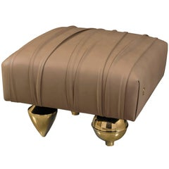 """Il Pezzo 1 Pouf"" ottoman surrounded of sinuous folds in fine quality leather"
