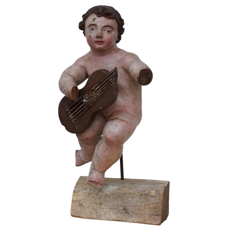 17th Century Italian Carved Painted Putto For Sale