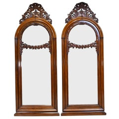 Pair of 19th Century Arched Mirrors with Carved Foliate Bonnet and Swag