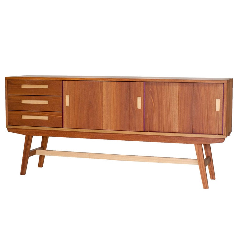 A contemporary style buffet or buffet handcrafted with use of traditional joints.  It has sliding doors and drawers.  It can be made on different wood species and sizes. The piece presented is made in cumarú, purple heart and pequi hardwoods.