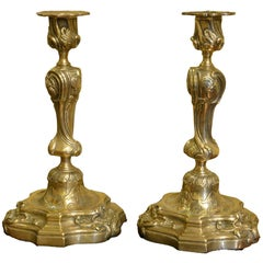 Pair of French Rococo Brass Candlesticks