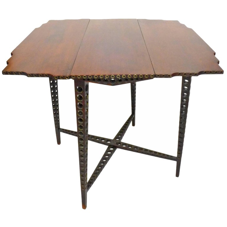 Early 20th Century Drop-Leaf Wood and Brass-Grommet Table For Sale